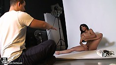 Glamorous and petite brunette poses for a backstage photoshoot