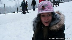 Hot teen has fun playing out in the cold snow with her cameraman