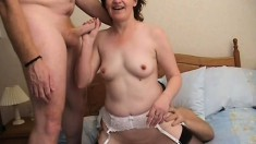 Lustful housewife has two horny strangers banging her pussy on the bed