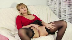 Horny blonde mom in black stockings has a young stud banging her pussy