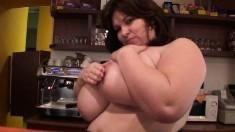 Seductive mature barmaid Anna puts her massive hooters on display