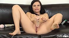 Brandi Belle jams a massive flesh coloured dildo into her giant snatch