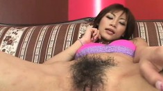 Gorgeous Oriental girl shows off her sweet cunt and blows a fat dick