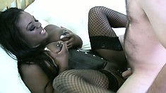 Ebony in fishnets Eden Adore slurps a white cock and gets nailed