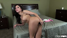 Aleksa Nicole rubs her well-trimmed pussy by the edge of the bed