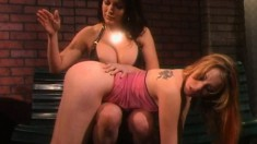 Busty Mistress Puts Her Slave Over Her Knee To Spank Her Sexy Ass