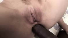 Uninhibited blonde gets her holes stretched with two massive black dicks