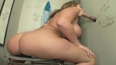 Buxom blonde Sara strokes her pussy while blowing a cock through a glory hole