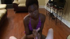Short-haired black babe gives a stiff white cock a fast and furious wanking