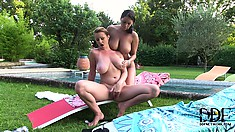 Naughty brunette MILFs enjoying the sun and rubbing their hootchies by the pool