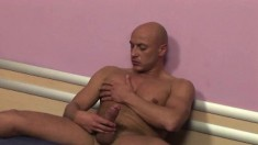 Lusty bald fucker gets naked and tries to suck his own huge rod