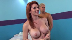 Sultry redhead with big tits Lylith Lust is in need of a hard fucking