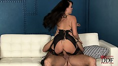 Frisky brunette with gigantic tits takes a ride on a big dick
