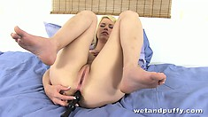 Whorish steamy bitch rubs her ripe pussy with a rubber penis