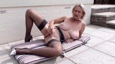 Mature Blonde In Stockings Fingering Herself