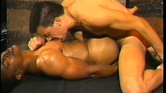 Vintage tape of hardcore interracial sex between two hung men