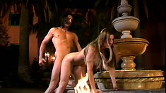 By the fountain, a busty redhead has a stud fucking her needy cunt like she deserves