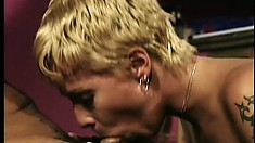 Short-haired blonde gets down with a ripped stud in a vintage tape
