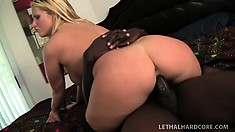 Striking blonde with big boobs and a sweet ass surrenders her twat to a black stud