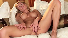 Randy is a curvaceous blonde who can please herself with a touch