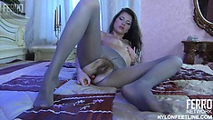 Sexy brunette in crotchless pantyhose toys her slippery slit