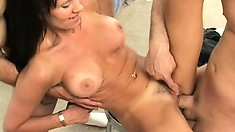 Lustful brunette milf with big tits Katie Heart gets fucked by two guys