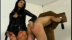 Mistress whips her slave's ass, then lets him worship her feet