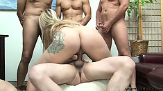 Tattooed blondie gets drilled in her furry muff in a hardcore cuckold gangbang