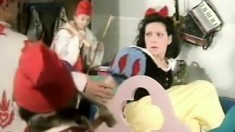 Snow White plays with a thick long candle for her seven dwarves