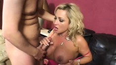 Buxom blonde milf in black stockings needs to get fucked by a young guy