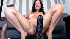 Busty brunette uses big sex toys