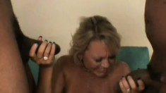 Luscious blonde cougar needs two huge black cocks drilling her holes