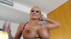 Big breasted blonde milf hangs on for a stiff cock and a deep fucking