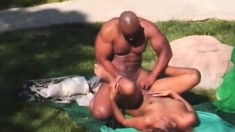 Big booty ebony girl surrenders her peach to a black stud by the pool