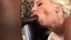 Big breasted blonde milf sucks and fucks a dark prick with pure desire