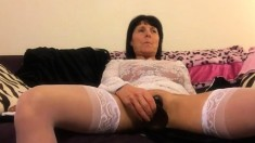 Sex Addict Mature In Stockings Shoves Toys Deep In Her Slit