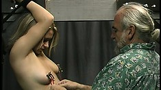 Joleen laughs a bit as he tickles her and then he clamps her nipples