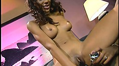 Sexy black whore grinds on her girlfriend's big strap-on dildo