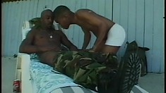 Two horny black studs step outside and explore their gay desires