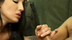 Skinny brunette enjoys a cigarette and strokes a fat prick to orgasm